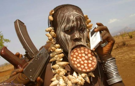 Mursi tribesman in Southern Ethiopia with iPod