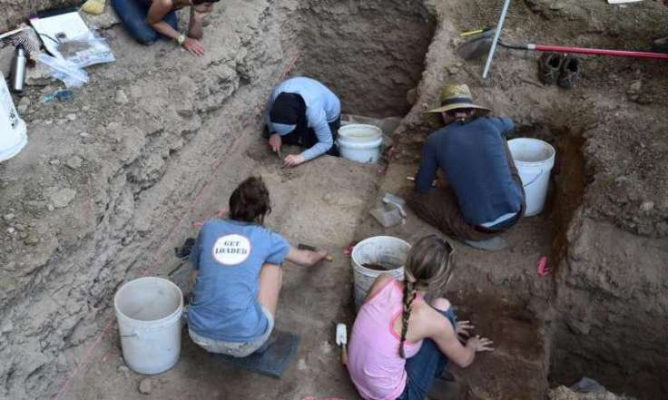 University of Wyoming students excavate a prehistoric rock shelter in the Big Horn Mountains of northern Wyoming during the summer of 2015. Hearths excavated at sites such as this provided many of the radiocarbon dates for new research showing that hunter-gatherers in the region that is now Wyoming and Colorado grew at the same rate as farming societies in Europe. Credit: UW Photo Read more at: http://phys.org/news/2015-12-growth-farming-non-farming-prehistoric-people.html#jCp