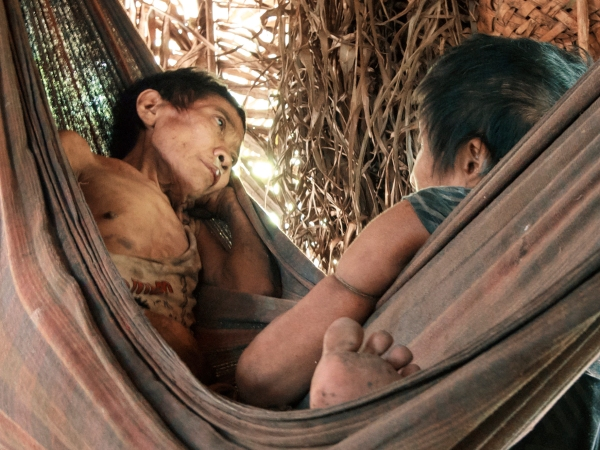 Jakarewãja and Amakaria, two women from endangered Awá tribe from the Brazilian Amazon, pictured while sick with tuberculosis after being led out of the forest in this 2015 photo. (Courtesy of Survival International)