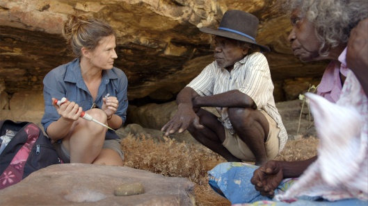 Researcher Elspeth Hayes with Mark Djandjomerr and traditional owner May Nango extracting comparative samples at a cave adjacent Madjedbebe. DAVID VADIVELOO / GUNDJEIHMI ABORIGINAL CORPORATION