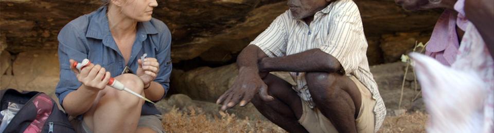 Researcher Elspeth Hayes with Mark Djandjomerr and traditional owner May Nango extracting comparative samples at a cave adjacent Madjedbebe. DAVID VADIVELOO / GUNDJEIHMI ABORIGINAL CORPORATION