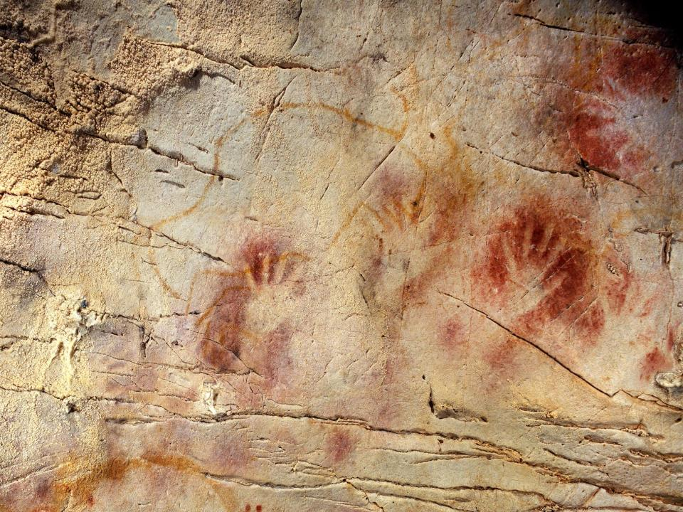 In El Castillo cave, hand stencils join a red disk (not pictured) that may be Earth's oldest cave art. PHOTOGRAPH COURTESY PEDRO SAURA VIA SCIENCE/AAAS