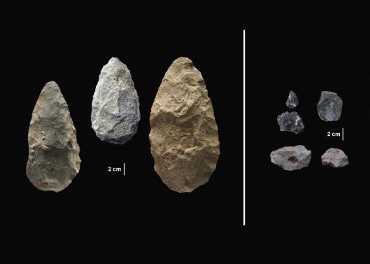 The sophisticated tools (right) were carefully crafted and more specialized than the large, all-purpose handaxes (left). Human Origins Program, Smithsonian